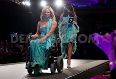 Stunning powerchair-using model in teal.  >>> See it. Believe it. Do it. Watch thousands of spinal cord injury videos at SPINALpedia.com