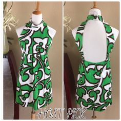 """Milly cotton stunning green/white dress Milly stunning green and white dress with chocolate brown accent color.  Absolutely beautiful print and unique back design. Hidden back zipper and button closure at neck. Wonderful condition and fully lined. Soft with a slight texture. Measures 35"""" long 18"""" across bust 15"""" across waist and Aprox 20"""" at hips Milly Dresses"""