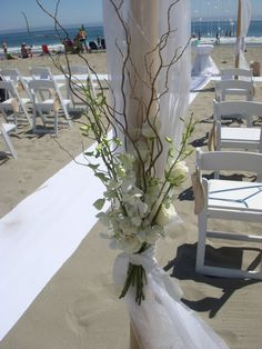 Wedding Arbor Floral Decoration. White roses and orchids.