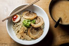 For a big bowl of comfort food in east London, this noodle joint definitely fills more than just a hole in the wall: http://www.timeout.com/london/restaurants/tonkotsu-east