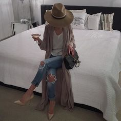 Topshop high crown fedora hat, Topshop gallop nubuck court shoes, white loose tee/cami, rip knee jeans, camel duster coat, bag