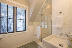 subway tiles, glass door, sink