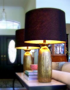 gold painted inside of lampshades... glamorous!