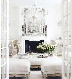 Comfy, cozy, classy, pretty, ... French doors, books, fireplace, flowers ... EVERYTHING I LOVE! WANT! http://media-cache-ec0.pinimg.com/originals/ff/e2/53/ffe25390874a848be1b851b64ec68055.jpg