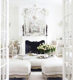 Comfy, cozy, classy, pretty, ... French doors, books, fireplace, flowers ... EVERYTHING I LOVE! WANT! http://media-cache-ec0.pinimg.com/originals/ff/e2/53/ffe25390874a848be1b851b64ec68055.jpg
