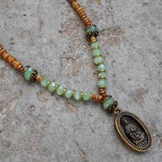 108 bead sandalwood mala with quan yin pendant