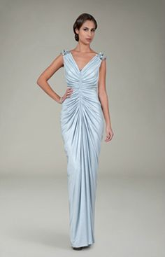 This gown has gorgeous draping and ruching.  A very elegant look for a formal or black tie wedding.