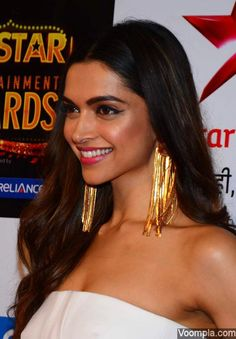 Bollywood's gorgeous diva Deepika Padukone - wearing a strapless white Stella McCartney dress and gold earrings by Valliyan. via Voompla.com
