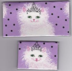 """Princess Kitten Kitty Cat Purple Checkbook Cover Set by Tickled Pink Boutique. $9.50. Fun and functional for every day use without paying a designer price for a designer name!  The sturdy clear PLASTIC 12 gauge lightweight VINYL COVER encases a fabric bonded design. Measuring 6 1/4"""" x 3 1/4"""",  the checkbook cover fits all standard bank checkbooks and banking registers.  All checkbook covers come with a register flap and a duplicate check flap just like the bank.    The drive..."""