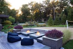 Active lifestyle landscape by Rocco Fiore & Sons, Libertyville, IL. (Double fire pit, volleyball,...