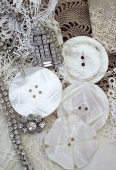 Beautiful carved MOP vintage buttons