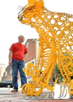 """Robert Machovec of Glen Rock fashioned a cat sculpture made out of old metal parts, many of them horseshoes. It can be seen on North George Street near North Street in York City. Nine large metal sculptures were installed on Wednesday, October, 3, 2012, along North George Street, all by six local artists. The official unveiling is Friday at 5:30 p.m. during First Friday at North Street and North George Street. Most pieces are made from """"salvaged industrial metals with a story to tell, and…"""