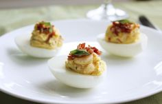 Lobster Deviled Eggs. A rich, buttery filling combined with fresh lobster and topped with crumbled bacon takes the classic to new heights.  http://justrealfoods.com/lobster-deviled-eggs/ < recipe
