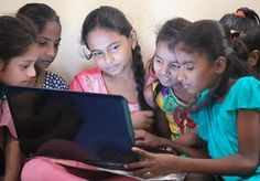 Girls learn how to use computers at a Dharavi Diary slum school in Mahim…
