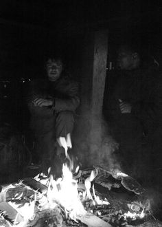 This is Sonny and Caesar at Gas Works Park last night standing around the fire to stay warm. Garland, Eric, Tim, Steve and Simon were also standing there. They are all homeless.   The big news of the evening was that Garland, who had received the beautiful pair of boots from Tim Taylor, was celebrating his one year anniversary of NO alcohol! He proudly talked about how different his life was now that he wasn't drinking! 12/30/2011