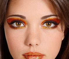 GET THE LOOK   SUN KISSED    You'll need Glitterbug Skin and Eye Glue, Glitterbug Make Up Brush Kit, Metallic Gold, Yellow Gold, and Orange Glitter Dust. For the lips you'll need long wear lipstick of your color choice, Metallic Gold Glitter Dust and Glitterbug Lip Glue. Add your preferred lip gloss for shine!