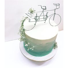 Close up of a tandem bike cake topper