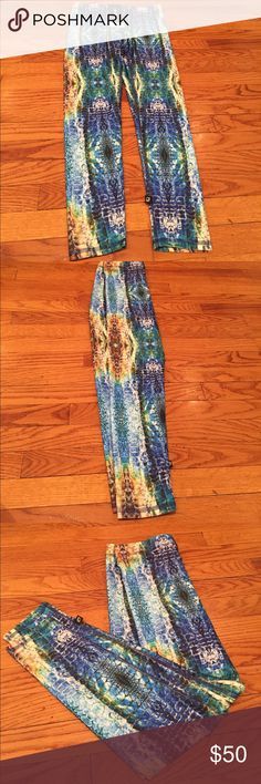 Zara Terez Multi colored reptile look Leggins Fun colored reptile look Leggins in shades of blue green and brown. Measurements are 28 inch waist, 8 inch rise, 26 inch inseam. So pretty it'll make your workouts exciting! Zara Terez Pants Leggings