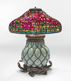 "Tiffany Studios, ""PEONY"" TABLE LAMP with a rare reticulated blown-glass ""Crab"" base, c1905. Sold Sothebys 2014 for $521,000."