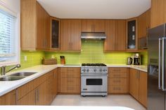 """Renovated with class and taste ... Caesar Stone Counter, Bamboo Cabinets & top of the line Stainless Steel Appliances ... a real """"WOW"""" for all those Chef's. 3573 Irwin Crescent, Mississauga, Ont."""