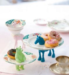Mix plastic animals with vintage Cups and saucers