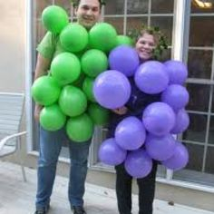 Homemade grape costume with balloons...but we can use green curling ribbon for the top and brown or green leggings for the stem.