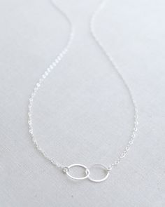 Silver Double Circle Necklace by Olive Yew. A classic dainty double circle necklace fits any woman's style. Also available in gold. Gold Circle Necklace, Letter Necklace, Necklace Charm, Handmade Necklaces, Silver Necklaces, Jewelry Necklaces, Handmade Jewelry, Olives, Rose Gold Jewelry