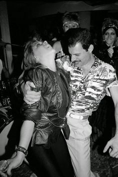 """≧◔◡◔≦That night of the Queen after party Freddie made a point of being seen with Mary Austin on his arm. His friend Jim Hutton was nowhere in sight."""""""