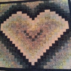 Awesome watercolor heart that a client made and we quilted for her! #longarmer #longarmQuilter #machineQuilter #machineQuilting #quilts #quilter #hearts #heartQuilt