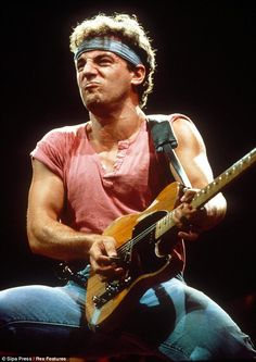 A legend: Bruce, pictured in 1985, is famous for his wild tousled hair and array of bandanas