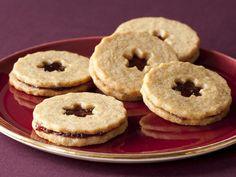 Hazelnut-Chocolate Linzer Cookies recipe from Aida Mollenkamp via Food Network Best Christmas Cookies, Holiday Cookies, Christmas Treats, Christmas Goodies, Christmas Desserts, Christmas Recipes, Christmas Fun, Holiday Baking, Christmas Baking