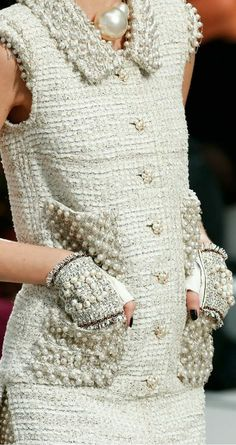 Chanel Couture Spring 2014....I'm working on beading a pair of fingerless gloves with pockets....and a jacket's collar... Love it.   CB