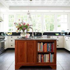 Cookbooks are kept in this storage-packed kitchen island. More island storage ideas: http://www.bhg.com/home-improvement/storage/kitchen/turn-your-kitchen-island-into-storage-central/?socsrc=bhgpin043012kitchenisland
