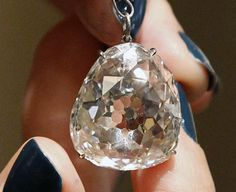 The Beau Sancy, a 34.98 carat diamond that will be put on sale by Sotheby's auction house in Geneva next month, is presented in Paris, Monday April 23, 2012. The Beau Sancy diamond, a stone of historical importance with a royal provenance stretching back