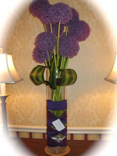 Allium/willow Grass in metal vase.