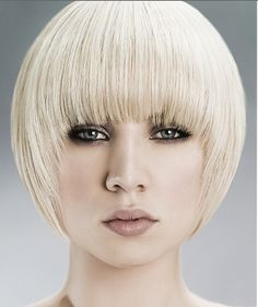 Blunt pixie haircut--I wonder what this would look like if the hair was a little messy?  too bowl-like for my liking