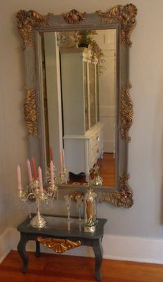 LOCAL PICK UP ONLY  This mirror is so elegant, so romantic, I love the style, a LARGE LEANING baroque boudoir framed mirror. Ornate and just will be a the focus in any room, I can see this in a brand new French chic room, dressing room, baby girl nursery or over a fireplace. Just stunning.  Painted in a charcoal grey, with gold accents and a dark stain, back is not painted still in original gold, can be painted the grey.  This frame is very hard to come by. I am showing in picture a small…