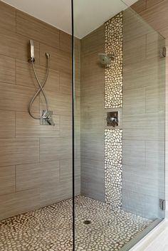 Textured porcelain shower like large horizontal tiles, but use blues random brick running down from shower head.