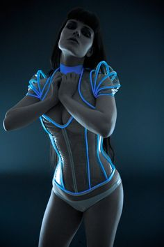 Clear PVC with luminescent icy blue glowing by ArtificeClothing.. ETSY (<3al) Reminds me of Tron but i think this is all clear instead of white/black combo