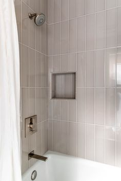 One of our favorite interior design before and after stories is the Stylish Suite Retreat! Two bathrooms are made contemporary and are transformed! Neutral Bathroom Tile, Tile Shower Niche, Subway Tile Showers, Shower Tile Designs, Tub Shower Combo, Shower Tub, Subway Tiles, Bathroom Design Inspiration, Bathroom Interior Design