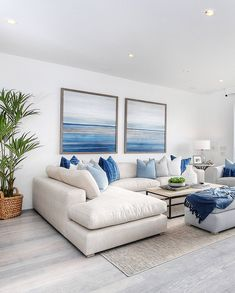 coastal living rooms Beautiful traditional style blue and white living room decor with white sectional sofa chaise , costal living room decor, modern beach house style decor Blue And White Living Room, Blue Living Room Decor, Bohemian Living Rooms, Home Living Room, Living Room Designs, Bohemian Decor, Hamptons Living Room, Modern Bohemian, White Living Room Furniture