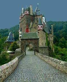 Burg Eltz Castle in Germany - what fascinated me, as much as the beautiful castles, was the roads... some of them hundreds of years old and still usable. Some of the castles too. Parts of them built in 600 AD. Awe inspiring.