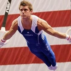 Sam Mikulak... twenty feet off the ground.. doing the impossible... still has awesome hair.