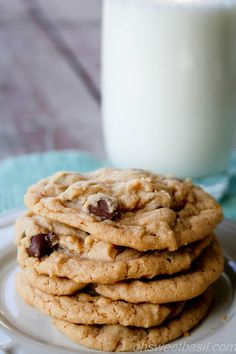 Peanut Butter Cookies with Chocolate Chips. The perfect peanut butter cookie thats tender, gooey and chocolatey! ohsweetbasil.com