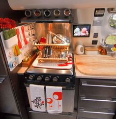 The kitchen setup in this Airstream trailer is to DIE FOR. That magnetic wall for utensils = brilliant!