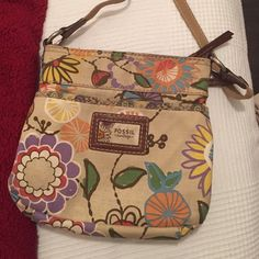 Flower-print Fossil purse - Vintage Collection This purse has an ultra-60s vibe. It is a canvas bag with a long strap and light brown leather detailing. There is one large compartment with 4 small compartments. Goes great with denim. Fossil Bags Shoulder Bags