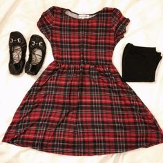 Black, White, Red Plaid Skater Dress I believe some still refer to this as a Babydoll dress. Very similar at least. Very cute with leggings and flats. It's only been worn once. Very flattering on even a chubby frame, as the waist is high set. It ties in the back. The material is a bit thin and a bit clingy (staticky) in my opinion but other wise it's a winner. In better than good condition. Almost Famous Dresses