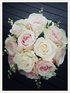 Wedding bouquet: roses, Lilly of the valley, pearls