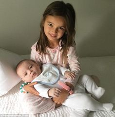 Amazing big sister! Ivanka Trump took to Instagram on Friday morning to share a photo of her four-year-old daughter Arabella holding her three-month-old son Theodore James