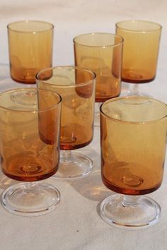 retro amber / clear glass stemmed glasses, vintage Luminarc - France Cavalier pattern- I have these glasses & I LOVE them-but beware, they are very thin!